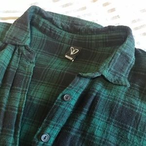 Woman's green and black flannel blouse